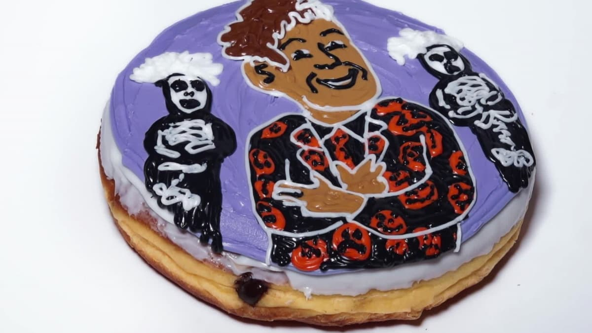Ride the Haunted Elevator with this David S. Pumpkins Donut of the Day.